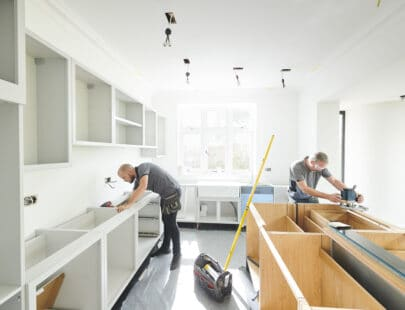 two joiners installing a kitchen