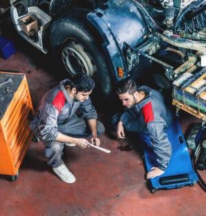 Auto and trucks mechanics working on a truck.